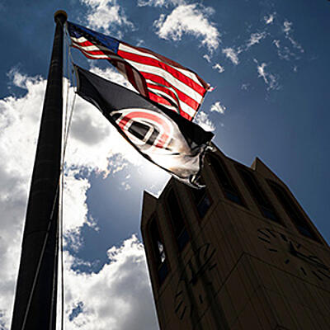 flag campanile sun behind